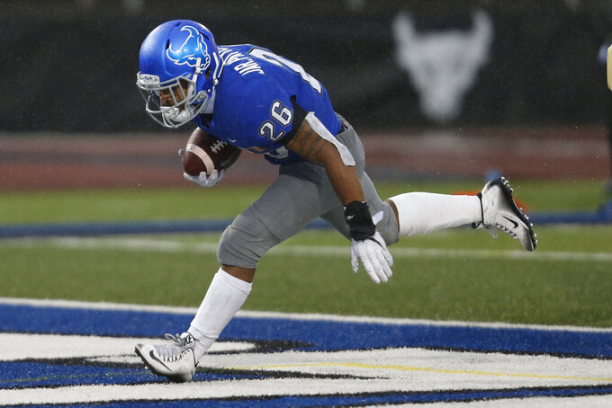 Buffalo running back Jaret Patterson (26) scores a touchdown in the first half of an NCAA college football game against Akron in Amherst, N.Y., Saturday, Dec. 12, 2020. (AP Photo/Jeffrey T. Barnes)