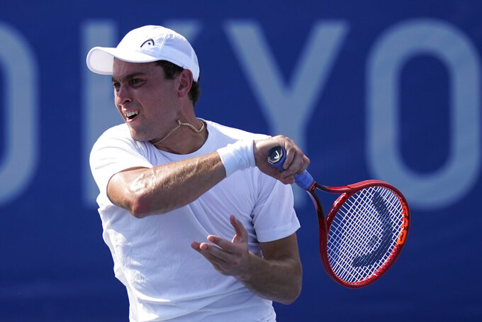 Aslan Karatsev, of the Russian Olympic Committee, returns to Tommy Paul, of the United States, during the tennis competition at the 2020 Summer Olympics, Saturday, July 24, 2021, in Tokyo, Japan. (AP Photo/Patrick Semansky)