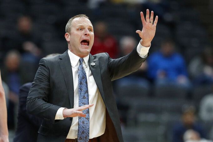 Drake head coach Darian DeVries yells from the sidelines during the second half of an NCAA college basketball game against Northern Iowa in the quarterfinal round of the Missouri Valley Conference men's tournament Friday, March 6, 2020, in St. Louis. (AP Photo/Jeff Roberson)