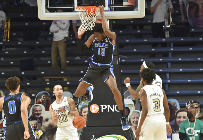 FILE - Duke forward Jaemyn Brakefield (15) hangs from the basket after a dunk against Georgia Tech during the second half of an NCAA college basketball game in Atlanta, in this Tuesday, March 2, 2021, file photo. Mississippi has seven newcomers, including Brakefield.  (Hyosub Shin/Atlanta Journal-Constitution via AP, File)