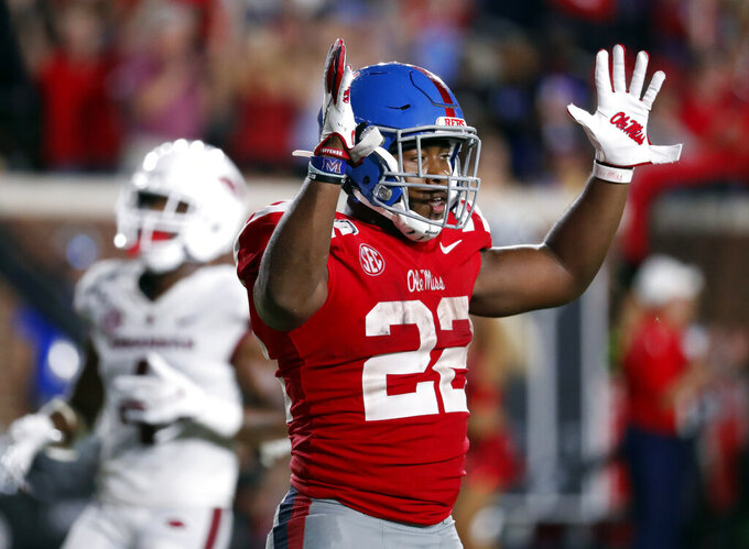 Mississippi running back Scottie Phillips (22) celebrates his touchdown run against Arkansas during the second half of an NCAA college football game Saturday, Sept. 7, 2019, in Oxford, Miss. Mississippi won 31-17. (AP Photo/Rogelio V. Solis)