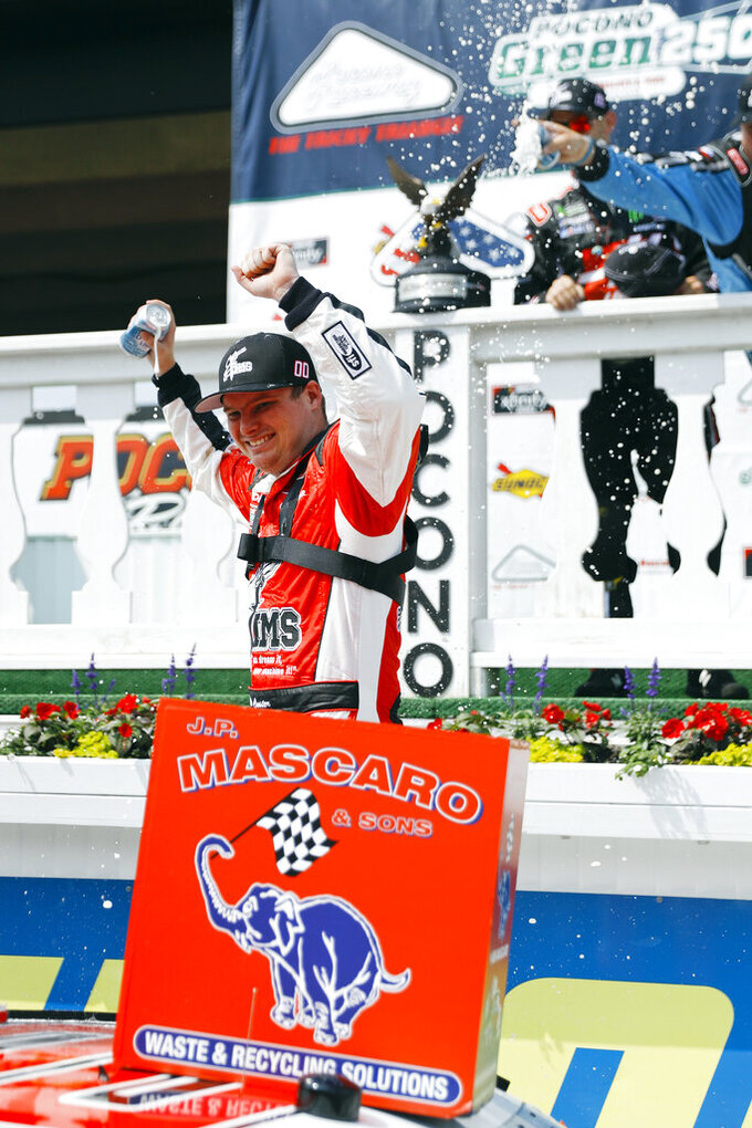 Cole Custer celebrates in Victory Lane after winning the NASCAR Xfinity Series auto race at Pocono Raceway, Saturday, June 1, 2019, in Long Pond, Pa. (AP Photo/Matt Slocum)