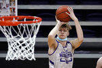 Washington's Cole Bajema shoots during an NCAA college basketball practice Tuesday, Oct. 27, 2020, in Seattle. Bajema is among several transfers to Washington who the Huskies are hopeful can all make an immediate impact. (AP Photo/Elaine Thompson)
