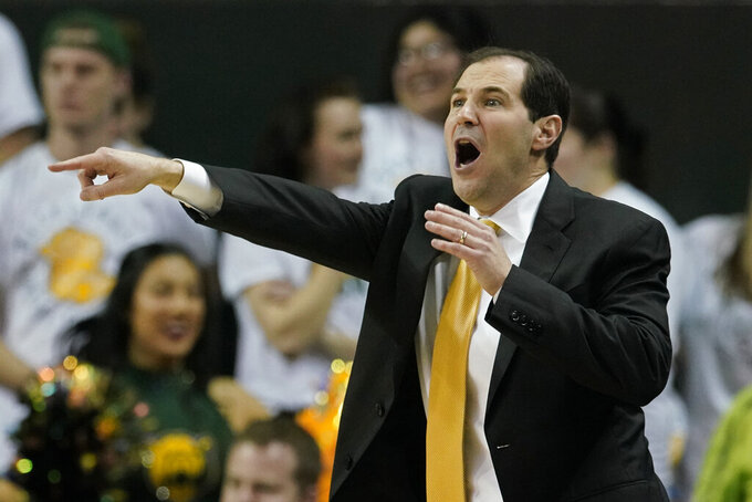 Baylor head coach Scott Drew directs his team against Texas Tech during the first half of an NCAA college basketball game in Waco, Texas, Monday, March 2, 2020. (AP Photo/Chuck Burton)