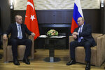 Russian President Vladimir Putin, right, and Turkish President Recep Tayyip Erdogan speak during their meeting in the Bocharov Ruchei residence in the Black Sea resort of Sochi, Russia, Tuesday, Oct. 22, 2019. Welcoming the Turkish leader in Russia's Black Sea resort of Sochi on Tuesday, Putin said their meeting is very important in the current tense situation in Syria.( Presidential Press Service via AP, Pool )