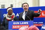 Sen. Chris Murphy, D-Conn., right, speaks at a protest outside the Supreme Court in Washington, Monday, Dec. 2, 2019, during arguments in the first gun rights case before the Supreme Court in nine years. The case was filed by three New York City gun owners who are challenging a ban on carrying a licensed handgun outside city limits to a gun range, shooting competition or second home outside city limits. (AP Photo/Susan Walsh)
