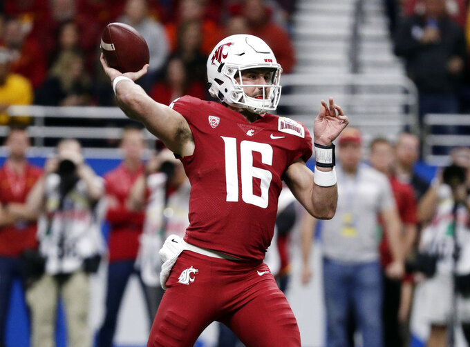 Washington State quarterback Gardner Minshew (16) throws a pass against Iowa State during the the first half of the Alamo Bowl NCAA college football game Friday, Dec. 28, 2018, in San Antonio. (AP Photo/Eric Gay)