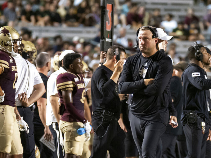 Texas State coach Jake Spavital watches a replay on the screen during the second half of the team's NCAA college football game against Baylor, Saturday, Sept. 4, 2021, in San Marcos, Texas. Baylor won 29-20. (AP Photo/Michael Thomas)