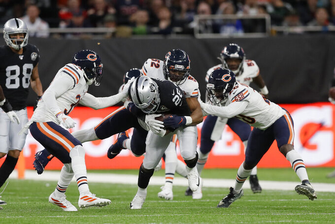Oakland Raiders running back Josh Jacobs (28) is tackled by dChicago Bears outside linebacker Khalil Mack (52) during the first half of an NFL football game at Tottenham Hotspur Stadium, Sunday, Oct. 6, 2019, in London. (AP Photo/Kirsty Wigglesworth)