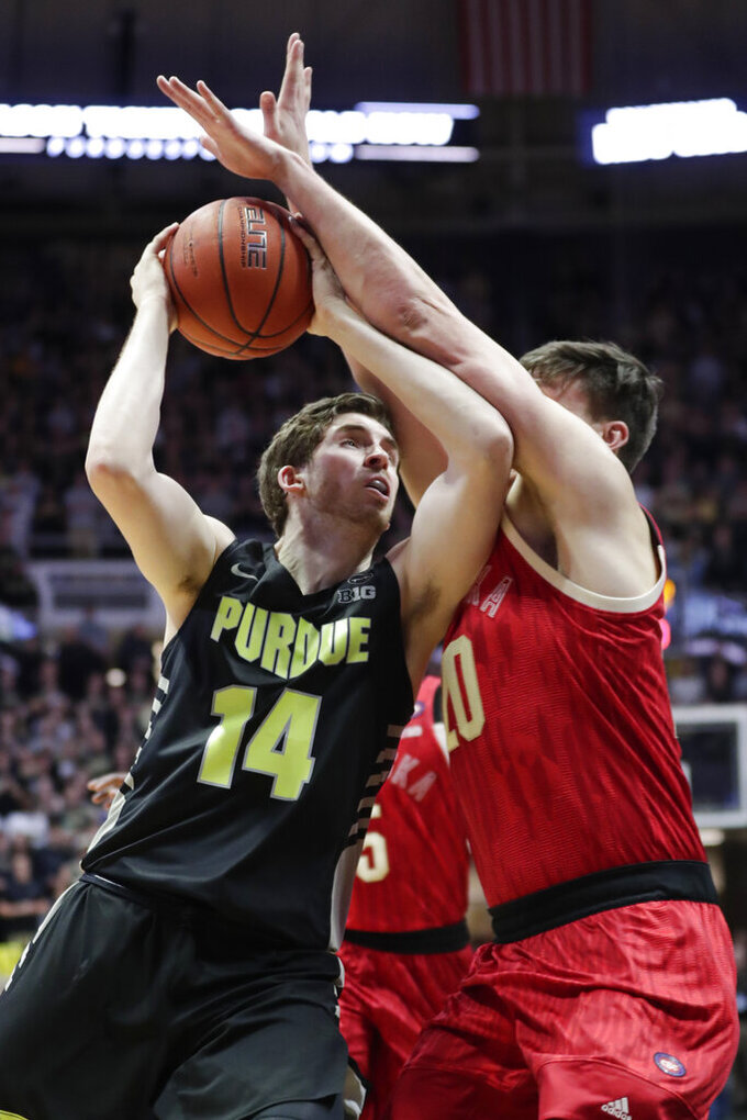 Nebraska forward Tanner Borchardt (20) blocks the shot of Purdue guard Ryan Cline (14) during the first half of an NCAA college basketball game in West Lafayette, Ind., Saturday, Feb. 9, 2019. (AP Photo/Michael Conroy)