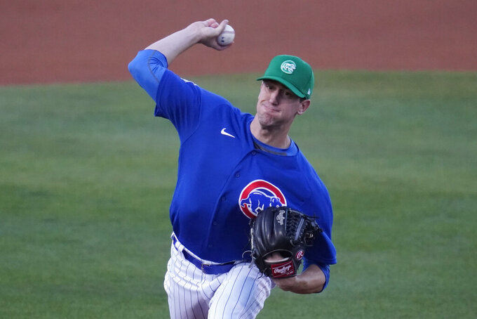Chicago Cubs starting pitcher Kyle Hendricks (28) throws during the first inning of a spring training baseball game against the San Diego Padres Wednesday, March 17, 2021, in Mesa, Ariz. (AP Photo/Ashley Landis)