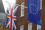 The European Union flag, right, and Britain's Union flag hang above the European Parliament Liaison Office in London, Tuesday, Jan. 21, 2020. Britain will leave the European Union on Jan. 31.(AP Photo/Kirsty Wigglesworth)