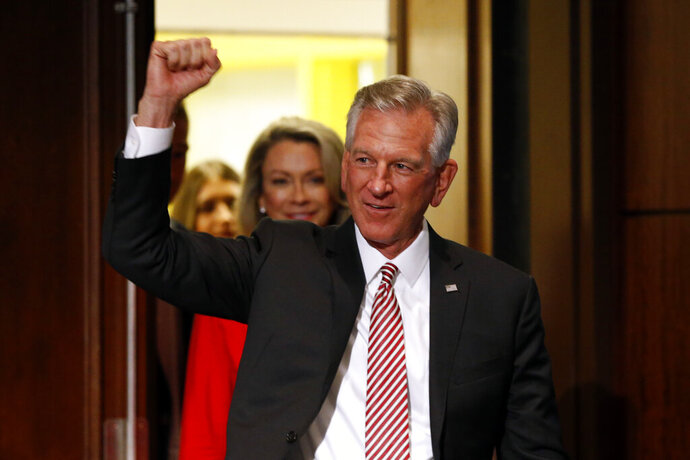 Former Auburn football coach Tommy Tuberville gestures while greeting supporters after he defeated Jeff Sessions in the Republican primary for U.S. Senate, Tuesday, July 14, 2020, in Montgomery, Ala. (AP Photo/Butch Dill)