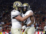 Colorado wide receiver Laviska Shenault Jr., right, celebrates his touchdown catch with Colby Pursell during the first half of an NCAA college football game against Southern California on Saturday, Oct. 13, 2018, in Los Angeles. (AP Photo/Marcio Jose Sanchez)