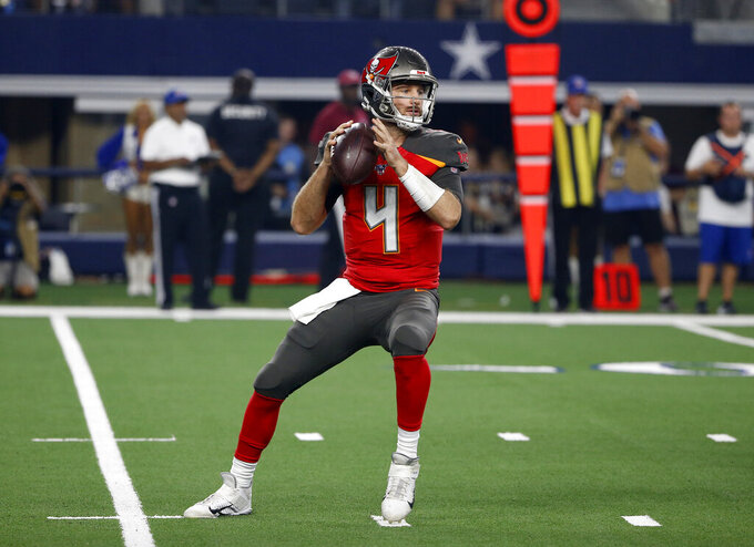 Tampa Bay Buccaneers quarterback Ryan Griffin (4) drops back to pass in the first half of a preseason NFL football game against the Dallas Cowboys in Arlington, Texas, Thursday, Aug. 29, 2019. (AP Photo/Ron Jenkins)