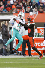 Cleveland Browns cornerback Greedy Williams, right, goes up for a pass interference against Miami Dolphins wide receiver DeVante Parker during the second half of an NFL football game, Sunday, Nov. 24, 2019, in Cleveland. (AP Photo/Ron Schwane)