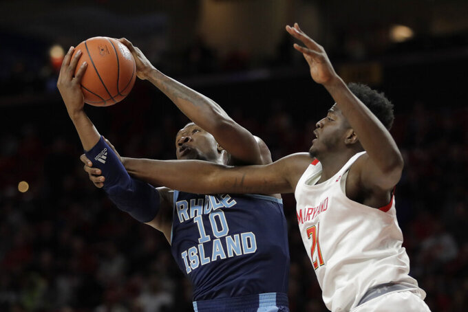 Rhode Island forward Cyril Langevine (10) goes up for a rebound next to Maryland forward Makhi Mitchell (21) during the second half of an NCAA college basketball game Saturday, Nov. 9, 2019, in College Park, Md. Maryland won 73-55. (AP Photo/Julio Cortez)