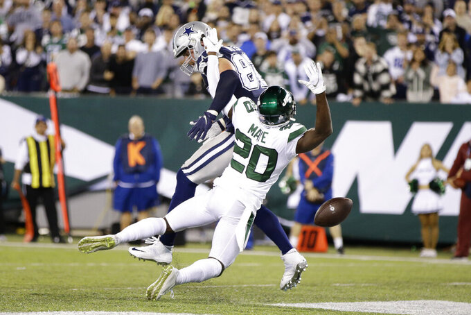New York Jets' Marcus Maye (20) breaks up a pass intended for Dallas Cowboys' Jason Witten during the second half of an NFL football game, Sunday, Oct. 13, 2019, in East Rutherford, N.J. (AP Photo/Frank Franklin II)