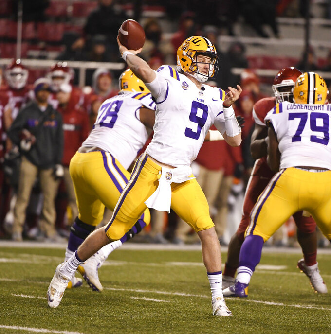 LSU quarterback Joe Burrow throws a pass against Arkansas during the second half of an NCAA college football game, Saturday, Nov. 10, 2018, in Fayetteville, Ark. LSU won, 24-17. (AP Photo/Michael Woods)