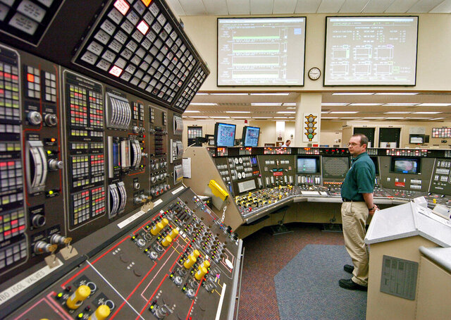 FILE – In this April 12, 2005, file photo, operator Kevin Holko monitors the control room during a scheduled refueling shutdown at the Perry Nuclear Power Plant in North Perry, Ohio. A federal court docket showed that