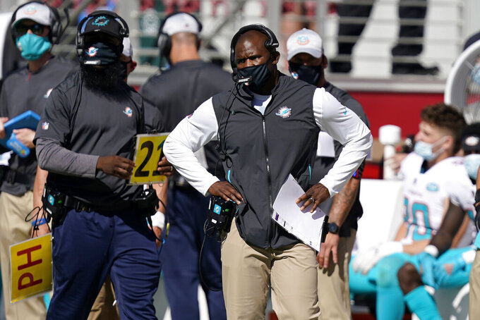 Miami Dolphins head coach Brian Flores watches on the sideline during the first half of an NFL football game against the San Francisco 49ers in Santa Clara, Calif., Sunday, Oct. 11, 2020. (AP Photo/Tony Avelar)