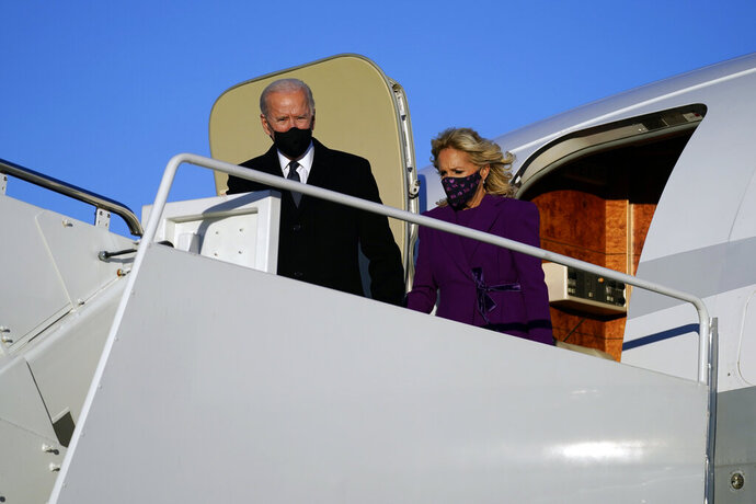 President-elect Joe Biden and his wife Jill Biden arrive at Andrews Air Force Base, Tuesday, Jan. 19, 2021, in Andrews Air Force Base, Md. (AP Photo/Evan Vucci)