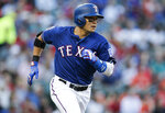 Texas Rangers' Shin-Soo Choo (17) rounds the bases after hitting a solo home run during the first inning of a baseball game against the Houston Astros, Saturday, July 13, 2019, in Arlington, Texas. (AP Photo/Brandon Wade)