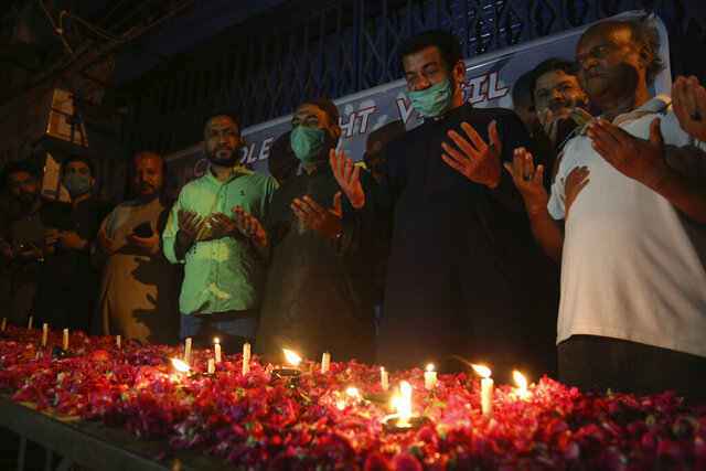 People attend candlelight vigil for victims of the crash of a state-run Pakistan International Airlines plane on Friday, in Karachi, Pakistan, Wednesday , May 27, 2020. (AP Photo/Fareed Khan)