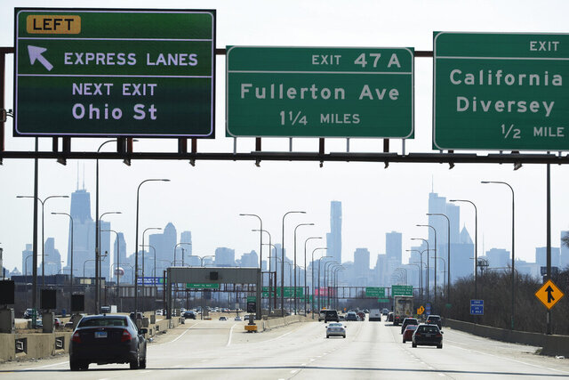 More traffic than usual on I-90 highway south bound in Chicago, Saturday, April 11, 2020. Data may show the number of COVID-19 cases in Illinois is growing at a slower pace than some projections had forecast, but Gov. J.B. Pritzker said his stay-at-home order will remain in place through the end of April.(AP Photo/Nam Y. Huh)