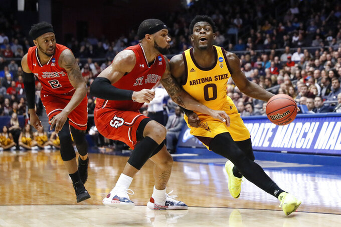 Arizona State's Luguentz Dort (0) drives against St. John's Marvin Clark II, center, during the first half of a First Four game of the NCAA men's college basketball tournament Wednesday, March 20, 2019, in Dayton, Ohio. (AP Photo/John Minchillo)