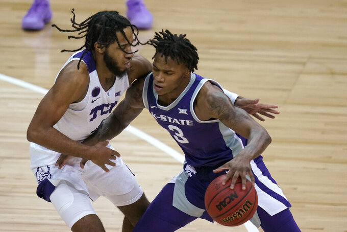 Kansas State guard DaJuan Gordon (3) drives on TCU guard PJ Fuller, left, during the first half of an NCAA college basketball game in the first round of the Big 12 men's tournament in Kansas City, Mo., Wednesday, March 10, 2021. (AP Photo/Orlin Wagner)