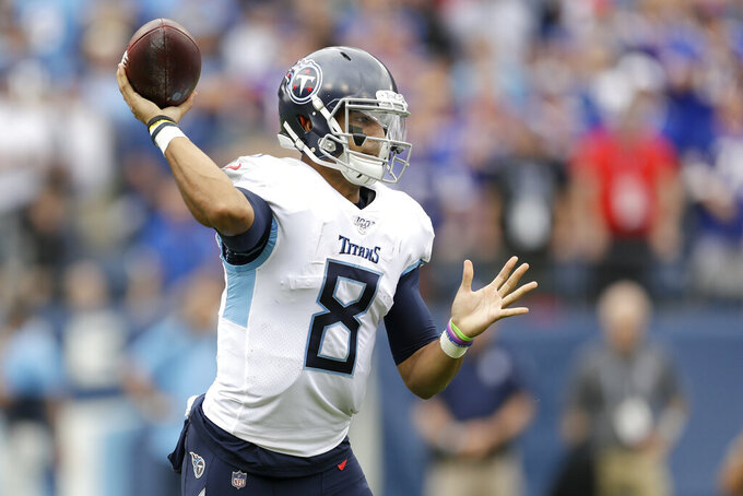 Tennessee Titans quarterback Marcus Mariota passes against the Buffalo Bills in the first half of an NFL football game Sunday, Oct. 6, 2019, in Nashville, Tenn. (AP Photo/James Kenney)