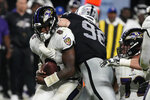 Las Vegas Raiders defensive end Maxx Crosby (98) tackles Baltimore Ravens quarterback Lamar Jackson (8) during the second half of an NFL football game, Monday, Sept. 13, 2021, in Las Vegas. (AP Photo/Rick Scuteri)