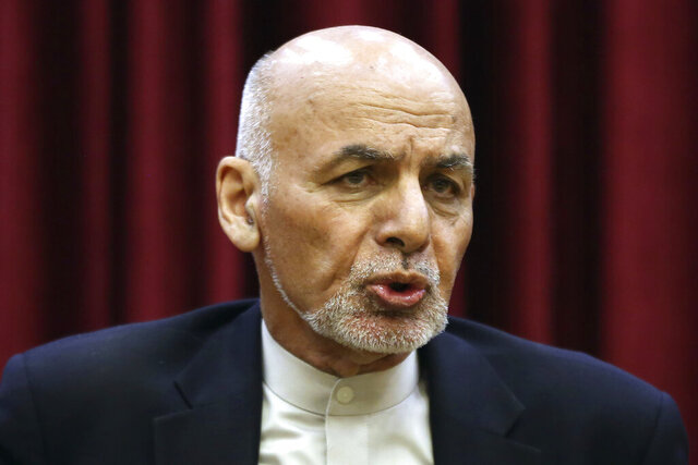 FILE - In this March, 1, 2020, file photo, Afghan President Ashraf Ghani speaks during a news conference at the presidential palace in Kabul, Afghanistan. Afghan President Ashraf Ghani dashed hopes Friday, July 31, 2020 of an early start to negotiations with Taliban insurgents, announcing the final 400 Taliban prisoners whose release is a prerequisite to start talks, will remain jailed. The announcement frustrates U.S. efforts to find an end to Afghanistan's years of relentless war. (AP Photo/Rahmat Gul, File)