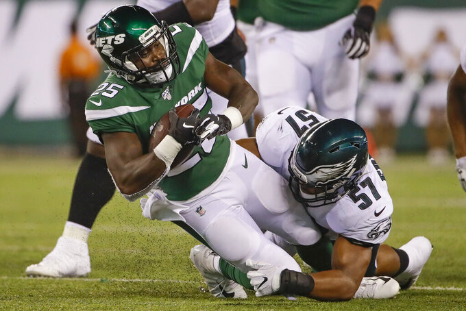 Philadelphia Eagles' T.J. Edwards (57) tackles New York Jets' Elijah McGuire (25) during the second half of a preseason NFL football game Thursday, Aug. 29, 2019, in East Rutherford, N.J. (AP Photo/Matt Rourke)