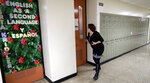 Boardman high school principal Cynthia Fernback checks classroom doors to make sure they are locked during a lockdown drill, Thursday, Feb. 14, 2019, in Boardman, Ohio. Some students around the country marked the anniversary of the school massacre in Parkland, Florida, with moments of silence Thursday or somber vigils while others sought to find threads of positivity in the fabric of tragedy. (AP Photo/Tony Dejak)