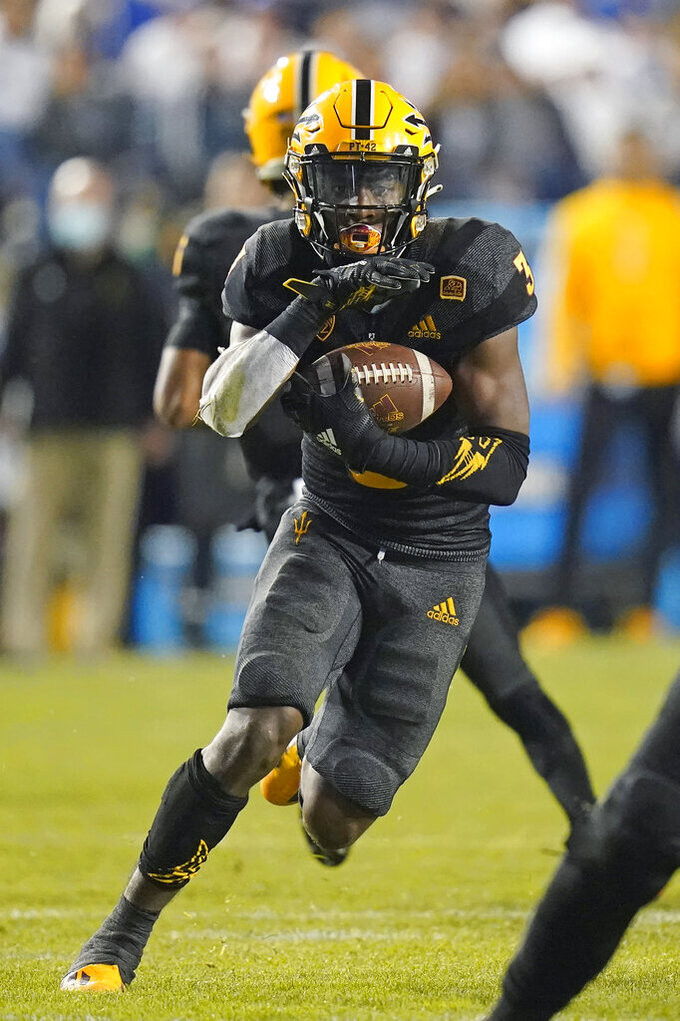 Arizona State running back Rachaad White (3) carries the ball during the second half of an NCAA college football game against BYU Saturday, Sept. 18, 2021, in Provo, Utah. (AP Photo/Rick Bowmer)