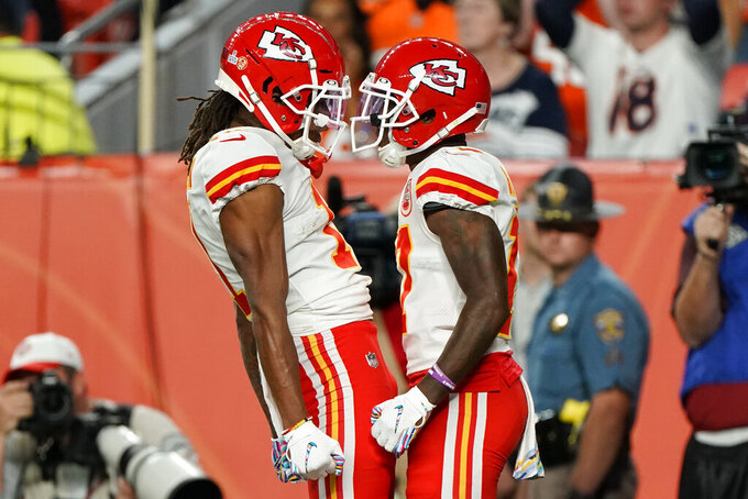 Kansas City Chiefs wide receiver Mecole Hardman, right, celebrates his touchdown with running back LeSean McCoy during the first half of an NFL football game, Thursday, Oct. 17, 2019, in Denver. (AP Photo/Jack Dempsey)