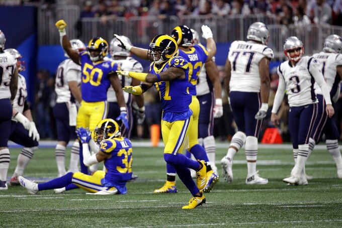 Los Angeles Rams' Sam Shields, center, celebrates a missed field goal by New England Patriots' Stephen Gostkowski (3) during the first half of the NFL Super Bowl 53 football game Sunday, Feb. 3, 2019, in Atlanta. (AP Photo/Patrick Semansky)