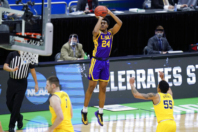 LSU guard Cameron Thomas (24) shoots over Michigan guard Eli Brooks (55) during the first half of a second-round game in the NCAA men's college basketball tournament at Lucas Oil Stadium Monday, March 22, 2021, in Indianapolis. (AP Photo/AJ Mast)