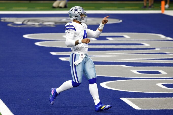 Dallas Cowboys' Dak Prescott (4) gestures to Amari Cooper standing nearby after throwing a touchdown pass to Cooper in the first half of an NFL football game against the Cleveland Browns in Arlington, Texas, Sunday, Oct. 4, 2020. (AP Photo/Ron Jenkins)