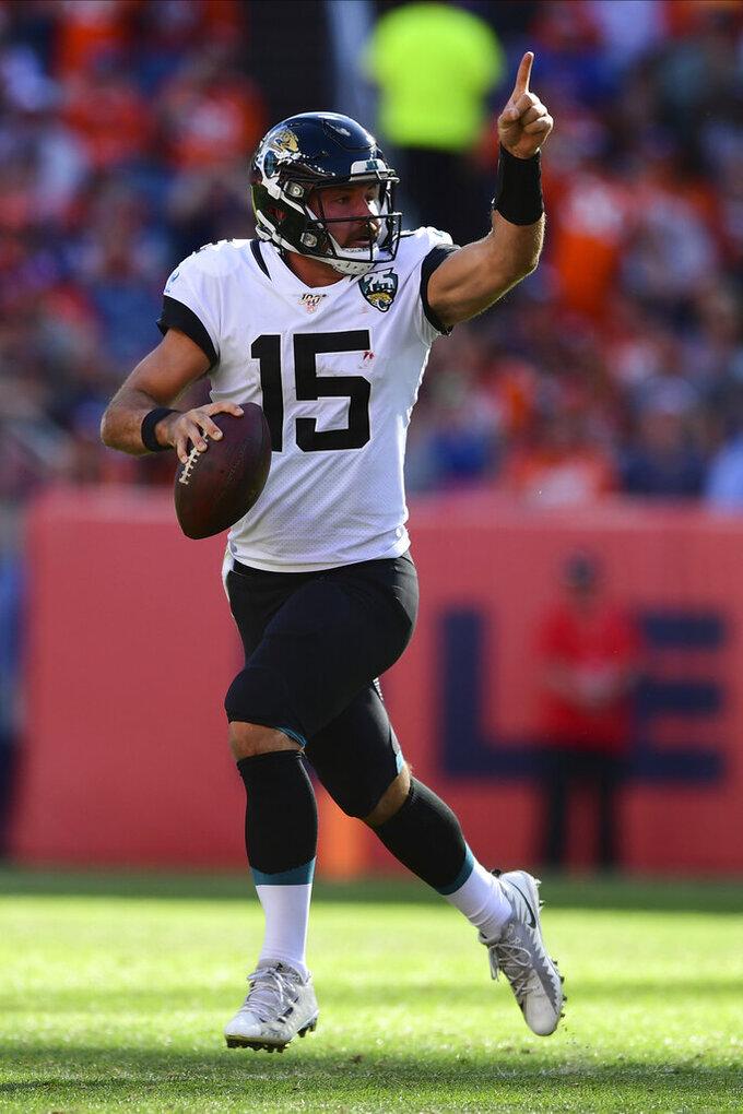 Jacksonville Jaguars quarterback Gardner Minshew II (15) rolls right and gestures during the second half in the NFL game against the Denver Broncos in Denver Sunday, Sept. 29, 2019.(Eric Bakke via AP)