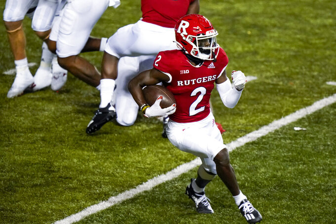 Rutgers wide receiver Aron Cruickshank (2) gains yardage in the third quarter of an NCAA college football game against Indiana, Saturday, Oct. 31, 2020, in Piscataway, N.J. (AP Photo/Corey Sipkin)