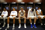 Duke guard Mike Buckmire, from left, forward Justin Robinson, forward Jack White, center Antonio Vrankovic and center Marques Bolden sit in the Duke locker room after an NCAA men's East Regional final college basketball game against Michigan State, Sunday, March 31, 2019, in Washington. Michigan State won 68-67. (AP Photo/Patrick Semansky)