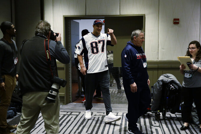 New England Patriots' Rob Gronkowski arrives for a news conference Wednesday, Jan. 30, 2019, ahead of the NFL Super Bowl 53 football game against Los Angeles Rams in Atlanta. (AP Photo/Matt Rourke)