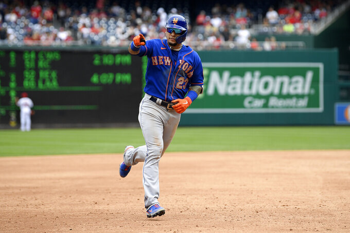 New York Mets' Javier Baez points to the stands as he rounds the bases on his home run during the third inning of a baseball game against the Washington Nationals, Sunday, Sept. 5, 2021, in Washington. (AP Photo/Nick Wass)