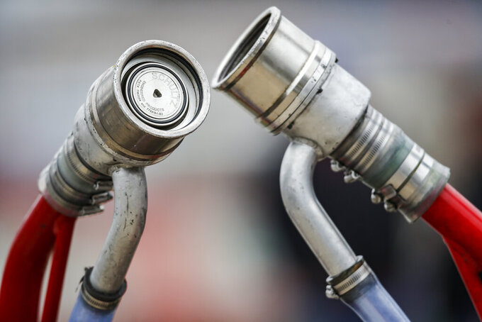 Fuel nozzles stand ready before a NASCAR auto race at Texas Motor Speedway, Saturday, March 30, 2019, in Fort Worth, Texas. (AP Photo/Brandon Wade)