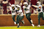 Baylor safety Christian Morgan, second from left, celebrates an interception in the first half of an NCAA college football game against Oklahoma Saturday, Dec. 5, 2020, in Norman, Okla. (AP Photo/Sue Ogrocki)