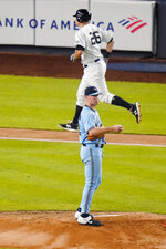 Toronto Blue Jays' Chase Anderson reacts as New York Yankees' DJ LeMahieu runs the bases after hitting a home run during the fourth inning of a baseball game Thursday, Sept. 17, 2020, in New York. (AP Photo/Frank Franklin II)