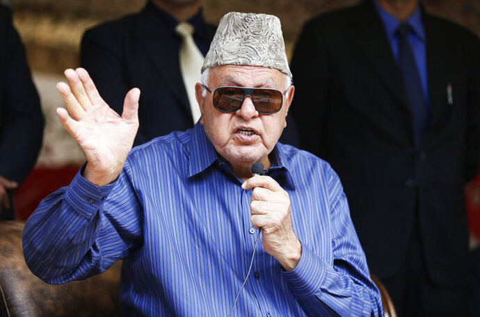 FILE - In this April 8, 2019, file photo, National Conference president Farooq Abdullah addresses his supporters during an election campaign rally in Srinagar, Indian controlled Kashmir. Abdullah, 81, also the former chief minister of Jammu and Kashmir, was arrested Monday under the Public Safety Act at his residence in Srinagar, the summer capital of the disputed region. (AP Photo/Mukhtar Khan, File)